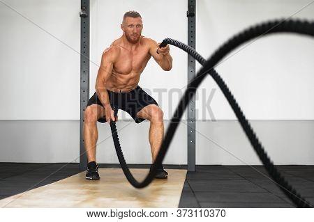 Gym Battle Rope Man Stamina Training Athlete Guy Fitness Exercising Endurance Indoor Workout. Handso