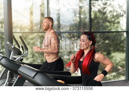 Gym Treadmill Running Trainer Man Woman Training Together Jogging Fitness Workout Warming Up Before