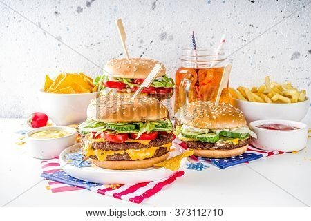 Celebrating Independence Day, July 4. Traditional American Memorial Day Patriotic Picnic With Burger