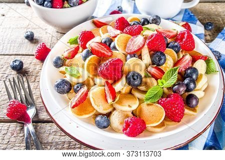 Trendy Mini Pancakes, Breakfast Cereal Pancakes With Various Summer Fruit And Berry