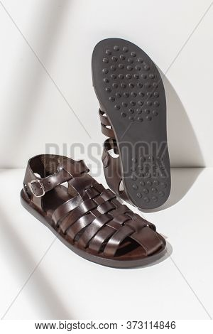 Male leather sandals on a white background. Stylish men's summer shoe