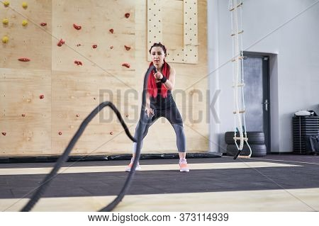 Gym Battle Rope Woman Stamina Training Athlete Guy Fitness Exercising Endurance Indoor Workout. Hand