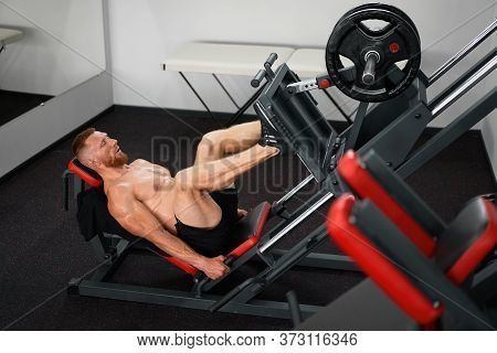 Gym Man Leg Press Machine Training Pushing Weight Handsome Caucasian Guy Training Define His Upper L