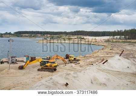 Sand Quarry Mining Industry Equipment Excavator Tractor Standing Sand Land Near Lake Water Industria
