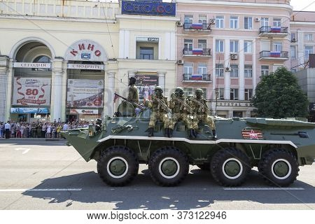 Donetsk, Donetsk People Republic, Ukraine - June 24, 2020: A Column Of Armored Personnel Carriers Wi