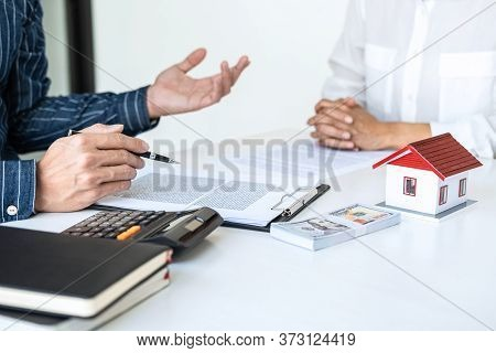 Real Estate Broker Agent Being Analysis And Making The Decision A Home Estate Loan To Customer To Si