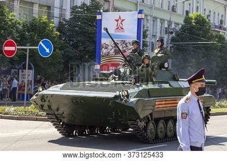 Donetsk, Donetsk People Republic, Ukraine - June 24, 2020: Landing Vehicles With Soldiers Move Along