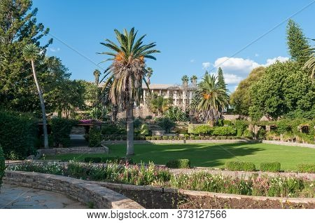 Windhoek, Namibia - May 17, 2011: View Of The Gardens At The Historic Parliament Building, Called Th