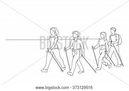 Group Of People Walks On Foot With Walking Sticks. Nordic Walking