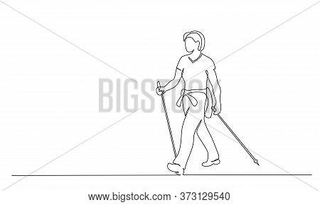 Woman Walks On Foot With Walking Sticks. Nordic Walking