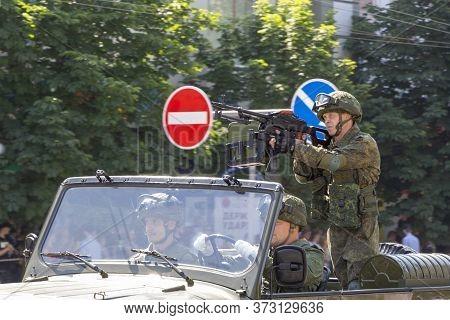 Donetsk, Donetsk People Republic, Ukraine, June 24, 2020: A Machine Gunner On A Military Vehicle Wit