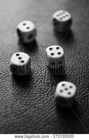 Dice Squares On A Black Table. Bw Photo.