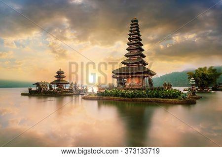 Ulun Danu Beratan Temple On Sunrise, A Famous  Landmark Located On The Western Side Of The Beratan L