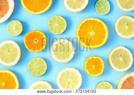 Collection Of Fresh Lime, Lemon, Orange, Citrus, Grapefruit Slice On Blue Background.