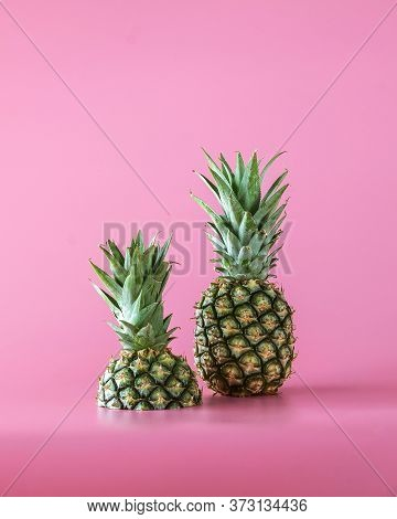 Pineapple Fruit Isolated On Pink Background. Healthy Lifestyle Concept.