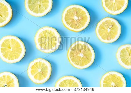 Collection Of Fresh Yellow Lemons Slice Isolated On Blue Background.