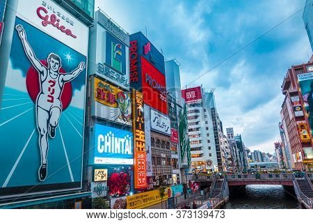 Osaka, Japan - 05/06/2019;  Crowd Of People Walking In Dotonburi, The Famous Shopping Center In Osak
