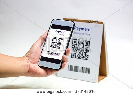 Hand Holding Smart Phone To Scan Qr Code Payment On White Background.