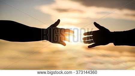 Mercy, Two Hands Silhouette On Sky Background, Connection Or Help Concept. The Outstretched Hands, S