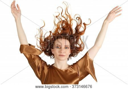 Portrait Of The Woman With The Flame Hairstyle And Outstretched Hands On A White Background
