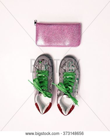 Trendy Creative Sneakers, With Green Shiny Laces And Silver Sequins And A Shiny Pink Clutch. Fashion