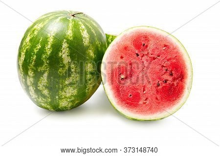 Fresh Organic Green Watermelon And Sliced Half Of Watermelon With Red Texture. Close-up