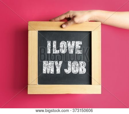 Employee Engagement Concept. Woman Holding Chalkboard With Text I Love My Job On Pink Background, Cl