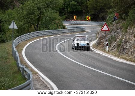 Skradin Croatia, June 2020 Simple White Old Fiat 126 Modified For Hill Climb Racing Up Hill, Going T