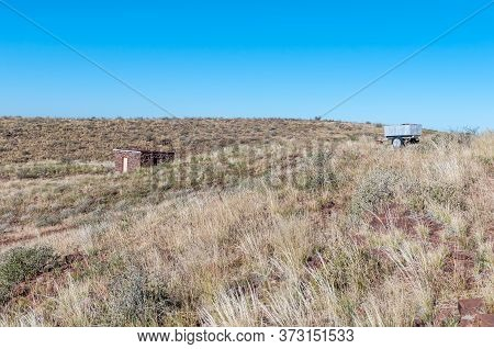 A Buiding And Water Trailer At The Camping Site On Brukkaros Mountain, An Extinct Volcano