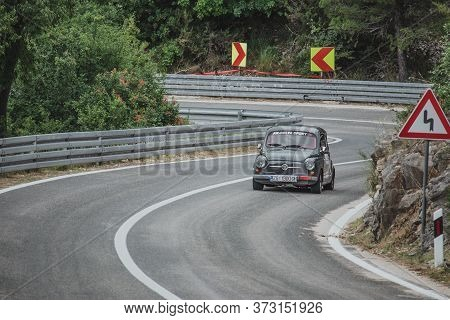 Skradin Croatia, June 2020 Simple White Old Fiat 500 Modified For Hill Climb Racing Up Hill, Going T