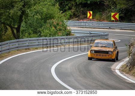 Skradin Croatia, June 2020 Simple Yellow Old Timer Fiat Modified For Hill Climb Racing Up Hill, Goin