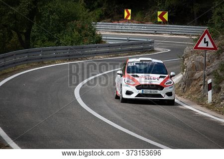 Skradin Croatia, June 2020 Red Ford Fiesta Going Uphill At High Speed, Racing On Public Road