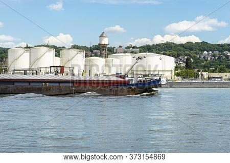 Storage Silos, Fuel Depot Of Petroleum And Gasoline On The Banks Of The River In Western Germany On