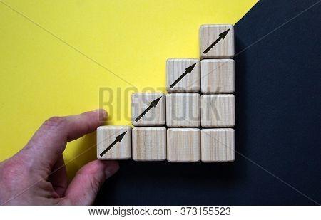Business Concept Growth Success Process, Close Up Man Hand Arranging Wood Block Stacking As Step Sta