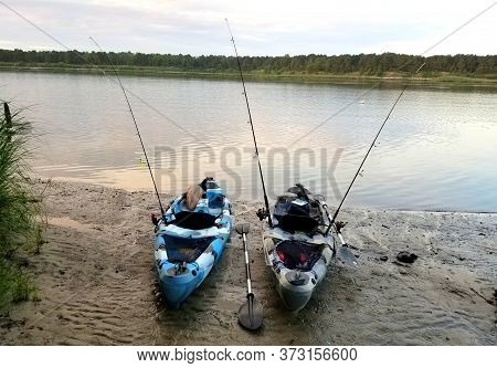 Millsboro, Delaware, U.s.a - June 20, 2020 - Two Kayaks Equipped With Fishing Rods On The Shore