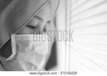 Sad Woman In Lockdown Quarantine Due To Coronavirus Covid 19 Pandemic, Looking Trough Window And Cry