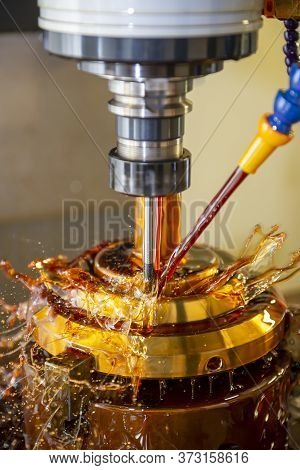 The Cnc Milling Machine Cutting The Tire Mold Parts With Liquid Oil Coolant Method In Vertical Scene