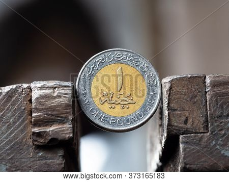 Dirham Coin Clamped In A Metal Vise. Currency And United Arab Emirates Economy Under The Onslaught,