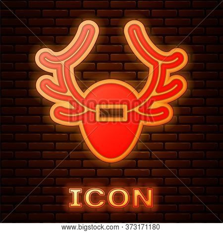 Glowing Neon Deer Antlers On Shield Icon Isolated On Brick Wall Background. Hunting Trophy On Wall.