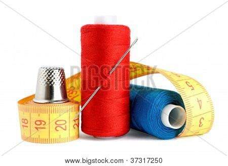 Spools Of Thread, Needle, Measuring Tape And Thimble Isolated On White Background