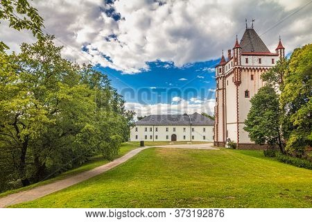 White Castle And White Tower In Hradec Nad Moravici Town, Czech Republic, Europe.