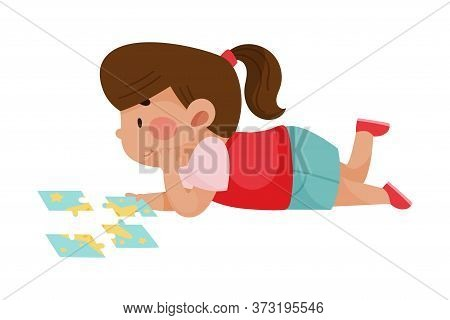 Little Girl Lying And Putting Together Jigsaw Puzzle Vector Illustration