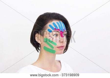 Face Taping, Close-up Of A Girls Face With Cosmetological Anti-wrinkle Tape. Face Aesthetic Taping.