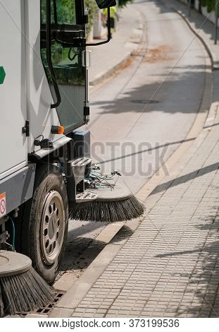 Sweeper Truck Industrial Vehicle Cleans Urban Streets Of The City On Urban Service Workers Backgroun