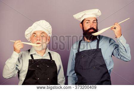 So Delicious. Mature Senior Bearded Men In Kitchen. New Recipe. Perfect Taste. Chef Men Cooking. Che