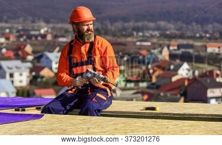 Roofer Constructing Roof. Man Roofing Surface. Materials Requirements. Install Partially Overlapping