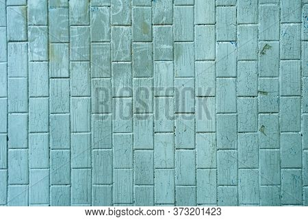 Pale Green Brick Wall Texture Background Material Construction. Dirty Brick Wall With Drips And Crac