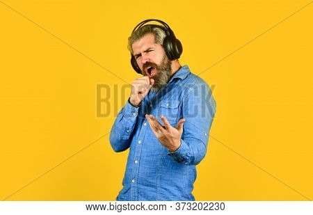 Singer On Rehearsal. Music Beat. Noise Cancelling Function. Man Bearded Hipster Headphones Listening