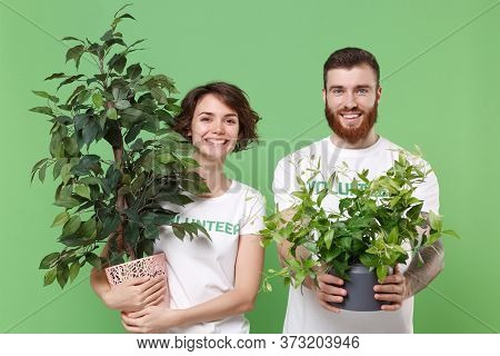 Smiling Two Young Friends Couple In White Volunteer T-shirt Isolated On Pastel Green Background In S