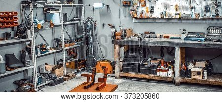 Garage, Service Area For Disassembling, Repairing Motorcycles, Car Station. Inside Workshop With Lar